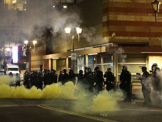 Phoenix police open fire with gas on protesters after
