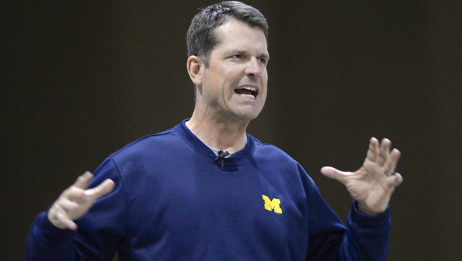 Michigan football coach Jim Harbaugh speaks at the Michigan High School Football Coaches Association Winner's Circle Clinic at the Lansing Center on Jan. 16, 2015.
