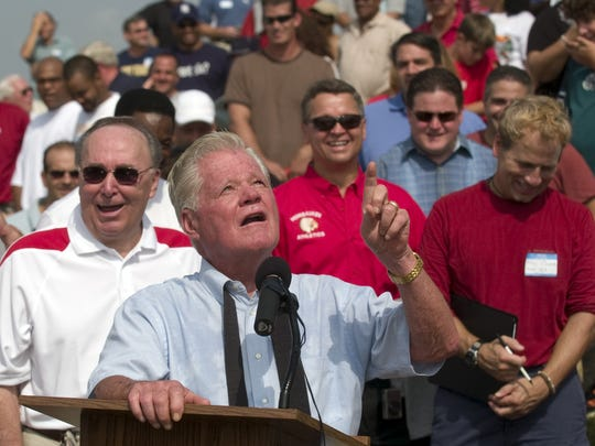 Vince McAneney looks skyward while talking about his late parents during a ceremony naming the Pennsauken High School football field in his honor in 2008.
