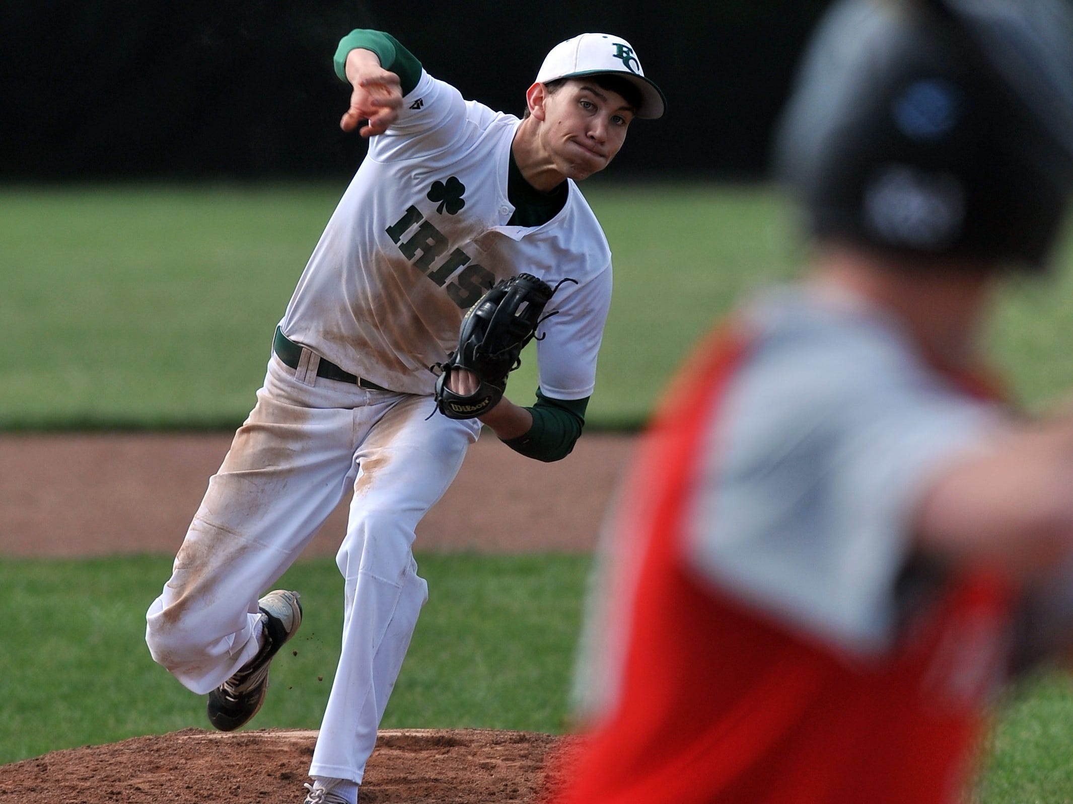 Fisher Catholic's Jared Faulkner pitches during Wednesday's game in Lancaster. The Irish won the game over Fairbanks 3-2.