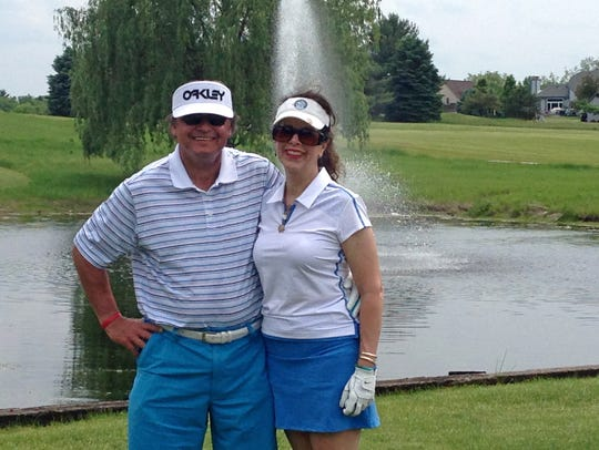 John Krueger and his wife Ann pose at Edgewood Golf