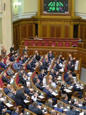 Deputies of Ukrainian Parliament vote for a bill dropping Ukraine's nonaligned status in Kiev on Dec. 23, 2014.