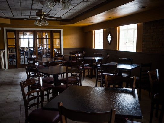 Dining room seating is ready for customers at Buon
