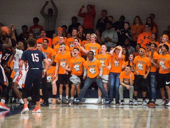 The Northeastern student section reacts to a play during