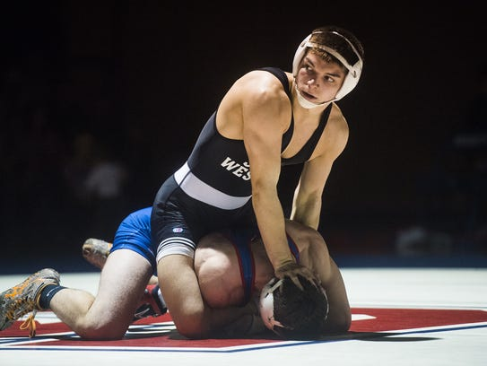 South Western's Owen Wherley grapples atop Spring Grove's