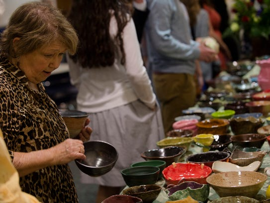 Gretchen Kindrick looks at bowls during the annual