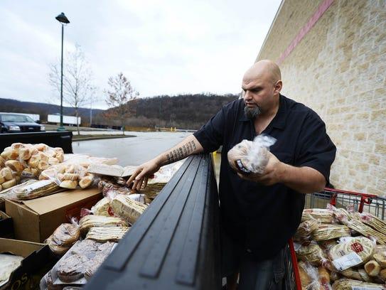 Braddock Mayor John Fetterman picks up goods that would