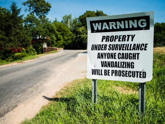 A sign near Sachs Covered Bridge displays a  warning