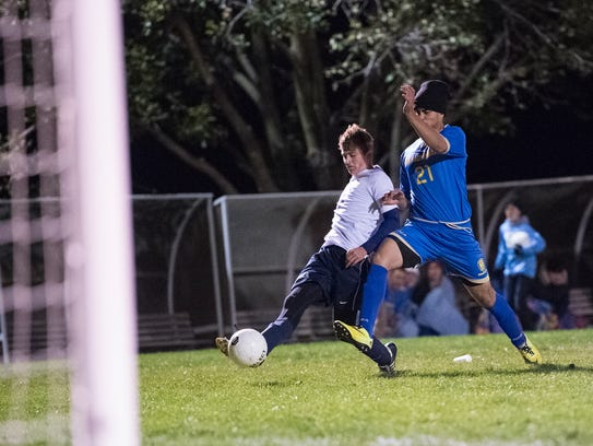 Shalom Christian Academy's Chase Martin (9) kicks the