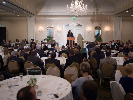 Anita Khan of Wells Fargo speaks during the AUM sponsored
