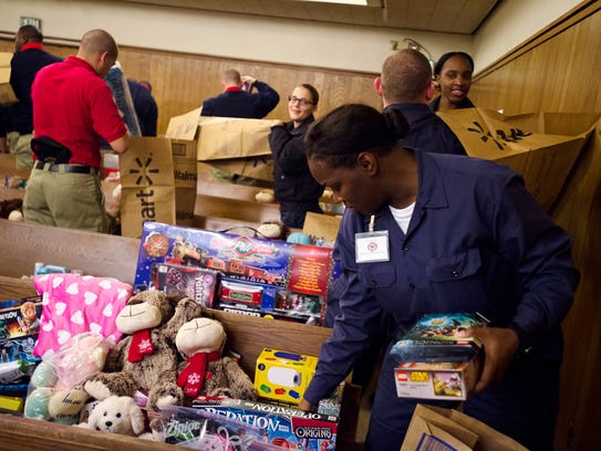 Montgomery Police Cadet Carrie Johnson packs gifts