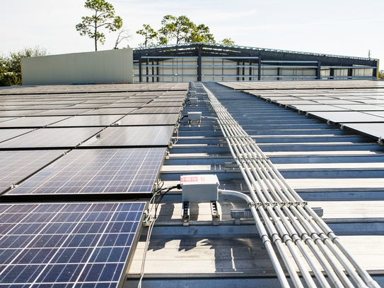 Solar panels are seen on the roof of a building at