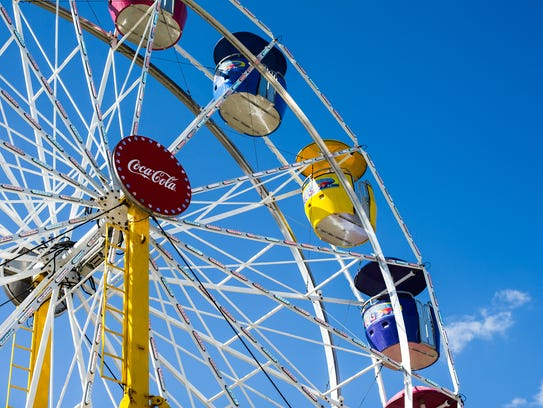 People ride on a ferris wheel at the Everglades Seafood