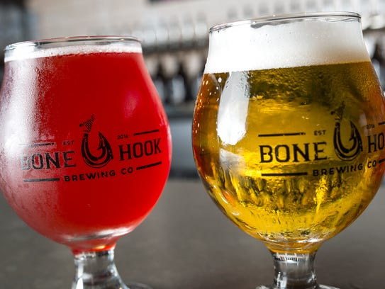 Two of Bone Hook Brewings beers sit side-by-side in