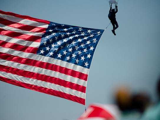 A parachuter with the American flag during the Maxwell Air Show at Maxwell Air Force Base in Montgomery on April 9. The Air Force, facing a shortage of pilots, is attempting to widen its pilot training pipeline by 25 percent to address stiffening competition for pilots nationwide.