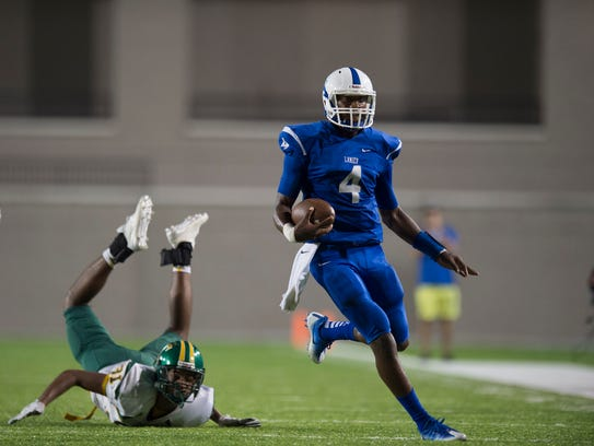 Lanier's James Foster (4) runs downfield during the