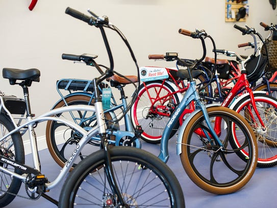 Bikes are on display inside a new Pedego shop in North