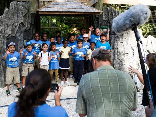 Students from Everglades City School pose for a video
