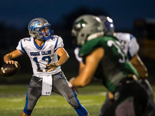 Barron Collier High School's Jacob Kuhlman looks to pass during a game against Palmetto Ridge High School in Naples, Fla., on Friday, October 13, 2017.