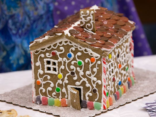 A gingerbread house, at a preview of a new German-themed
