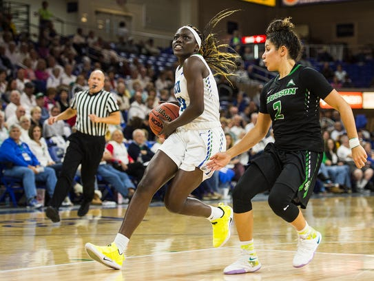 Florida Gulf Coast University's Nasrin Ulel goes up for a shot during a game against Stetson at Alico Arena on Saturday. The Eagles won, 80-40.