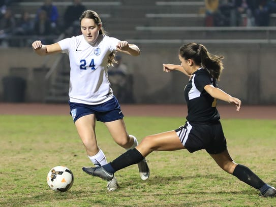 Golden West's Luna Pelayo lunges out to stop Redwood's