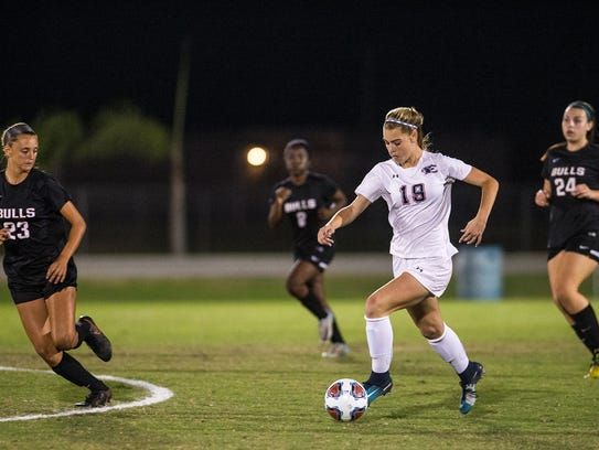Estero High School's Mackenzie Gorski bring the ball