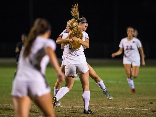 Estero High School celebrates a goal in the first half during a Class 4A regional final against Bloomingdale on Tuesday.