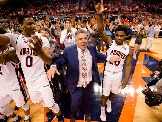 Auburn Tigers head coach Bruce Pearl celebrates with
