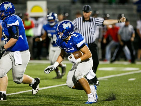 McNary's Junior Walling (2) carries the ball in a game