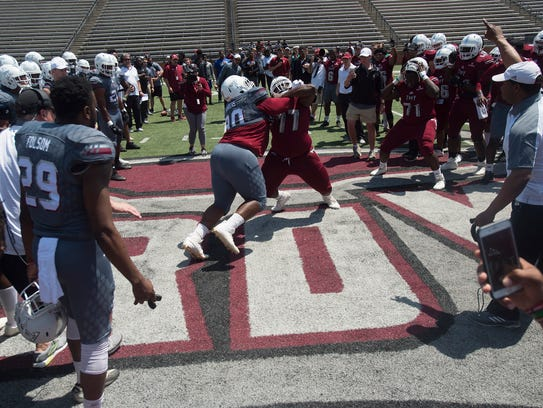Troy defensive tackle Trevon Sanders (90) competes