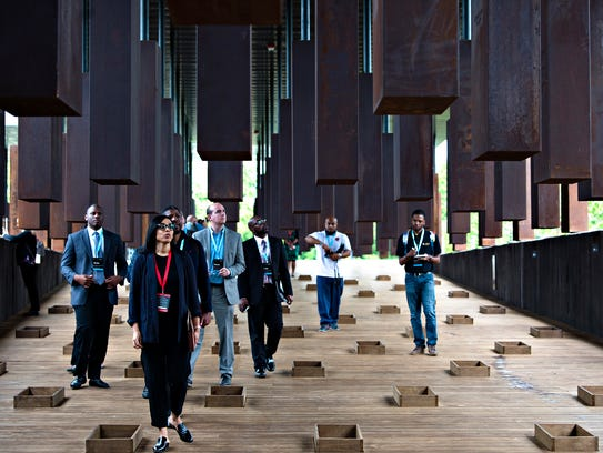 Media members tour the Equal Justice Initiative's National Memorial for Peace and Justice, which honors African-American lynching victims in 805 counties nationwide. Albert Cesare/Montgomery Advertiser via USA Today Network