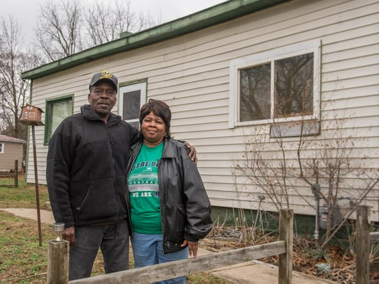Levi and Teresa Jenkins in front of their new home