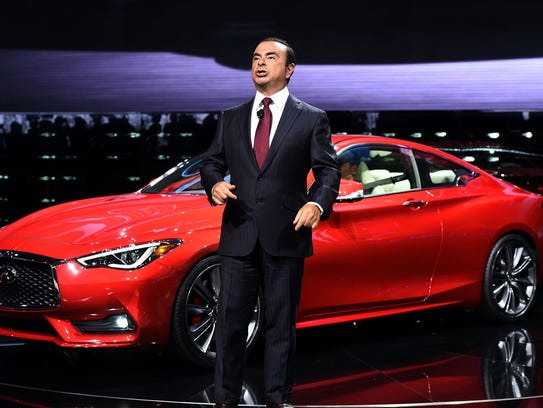 Nissan CEO Carlos Ghosn speaks after unveiling the