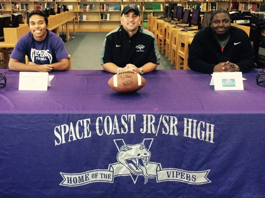 Nathan Camick (left) and T.J. Jackson sign letters