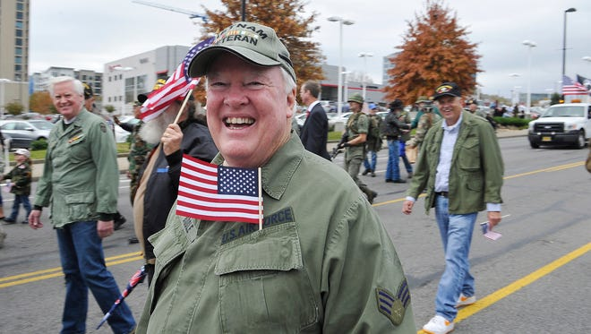 Former Tennessean sports columnist Joe Biddle makes his way down Broadway with other veterans in a Veterans Day Parade.