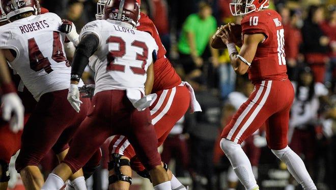 UL Ragin' Cajuns quarterback Jordan Davis (10) drops back to attempt a pass during the first half of an NCAA football game against the Troy Trojans at Cajun Field in Lafayette, La., Saturday, Dec. 5, 2015.