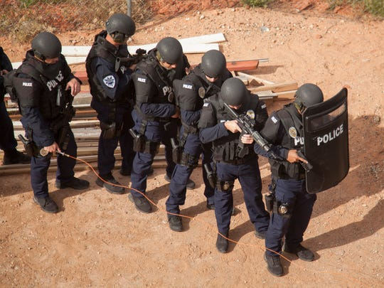 Members of the St. George Police Department demonstrate equipment and techniques to St. George City officials Thursday, April 14, 2016.