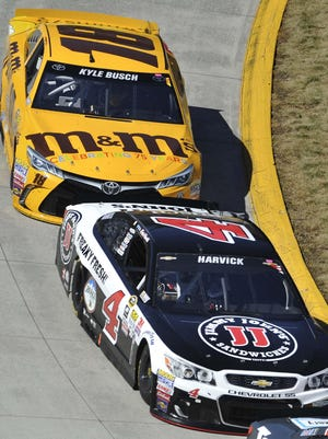 NASCAR Sprint Cup Series driver Kevin Harvick (4) races Kyle Busch (18) during Sunday's Alpha Energy Solutions 250 at Martinsville Speedway.
