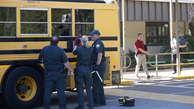 The Leon County Sheriff's Department inspects a bus at Killearn Lakes Elementary School where, what is suspected to be, an ammunition round broke the glass on a school bus window as children were boarding after school on Tuesday, March 22, 2016.