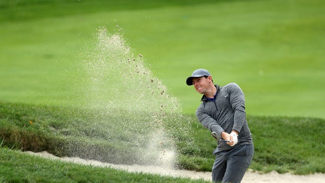 Rory McIlroy plays a shot from a bunker on the seventh hole during the final round Monday of the Deutsche Bank Championship at TPC Boston. McIlroy rallied from six shots down to win the championship.