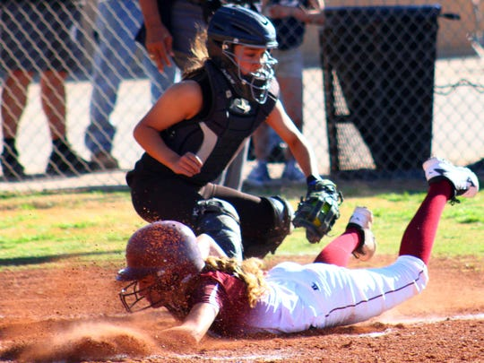 Tularosa eighth-grader Syanne Telles slides into home-plate Thursday afternoon.