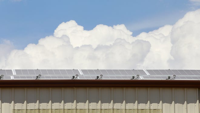 Solar panels cover a building at the Aztec Municipal School District office grounds on Wednesday August 17, 2016, in Aztec.