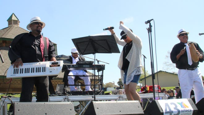 Impacto 5 band members (from right) Paco Sanchez, Clara Muñoz and David Sobranes perform at the Festival Tributo a Selena in Salinas Sunday.