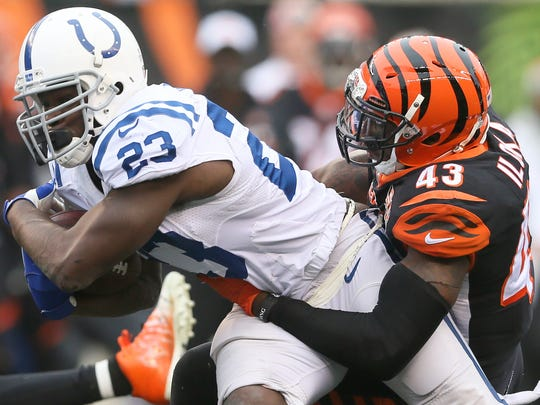Cincinnati Bengals free safety George Iloka (43) tackles Indianapolis Colts running back Frank Gore (23) in the third quarter during the Week 8 NFL game between the Indianapolis Colts and Cincinnati Bengals, Sunday, Oct. 29, 2017, at Paul Brown Stadium in Cincinnati.