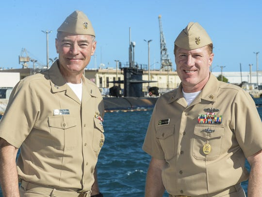 """Rear Adm. """"Fritz"""" Roegge, left, U.S. Pacific Fleet Submarine Force commander, poses for a photo with Force Master Chief Russ Mason at the Naval Base Guam in Sumay on Monday, Jan. 11."""