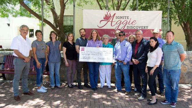 A new gift from Cowboys for Cancer Research, coupled with endowment earnings managed through the NMSU Foundation, creates a total of $175,000 to support active cancer research at NMSU. Cowboys for Cancer Research representatives alongside NMSU faculty investigators celebrate the gift at a recent check presentation event on the Las Cruces campus.