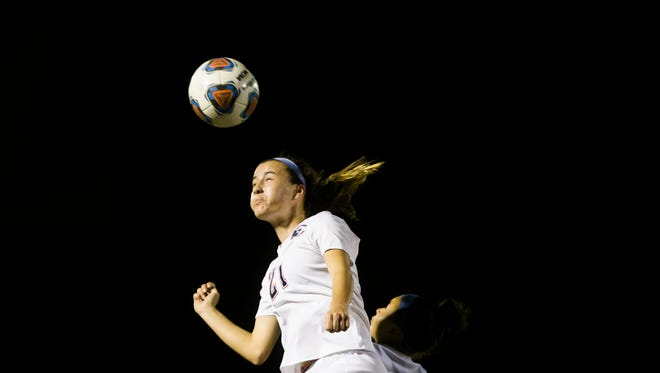 Estero junior Marin Yeagle heads the ball during a Class 4A state semifinal against Archbishop McCarthy High School on Feb. 16. The Wildcats face Montverde Academy for the state championship on at 7 p.m. Friday in DeLand.
