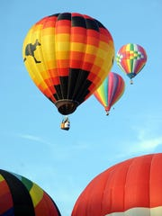Hot air balloons are launched during the final day of Dutchess County Regional Chamber of Commerce's 13th Balloon Festival on July 7, 2013.