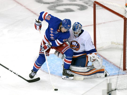 New York Rangers left wing Brendan Lemieux (48) skates in on New York Islanders goaltender Thomas Greiss (1) during the third period of an NHL preseason hockey game Tuesday, Sept. 24, 2019, at Madison Square Garden in New York. (AP Photo/ Bill Kostroun)